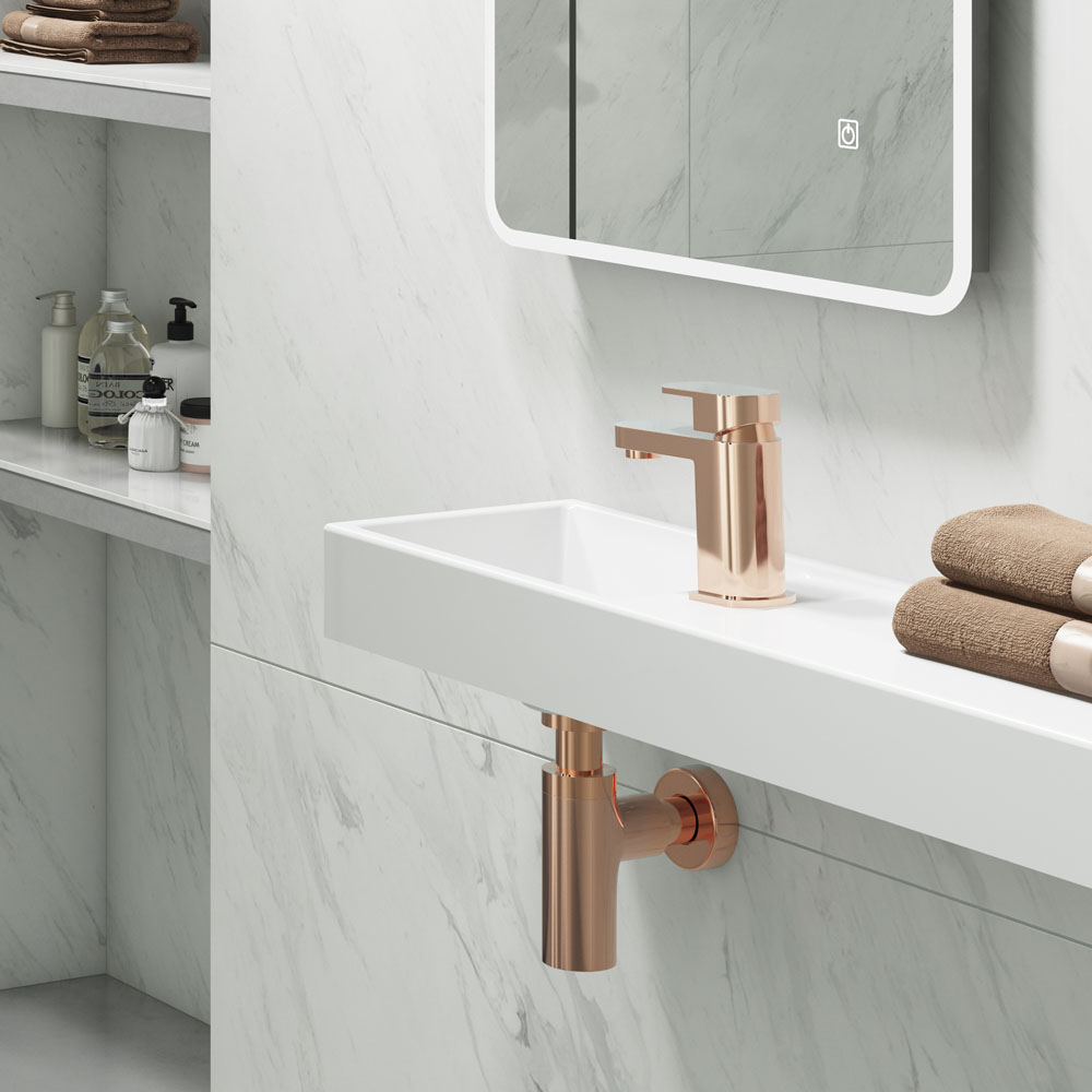 Amos Rose Gold Mono Basin Mixer Tap - AMOS004 - Close up image of rose gold bathroom tap in a white marble bathroom