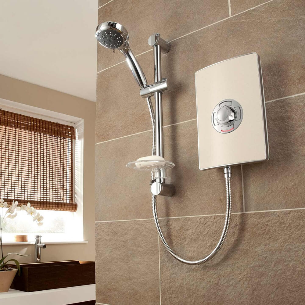 Triton - Aspirante 8.5kw Electric Shower - Riviera Sand - ASP08TLRSD - Close up image against a beautiful natural stone tiled bathroom wall