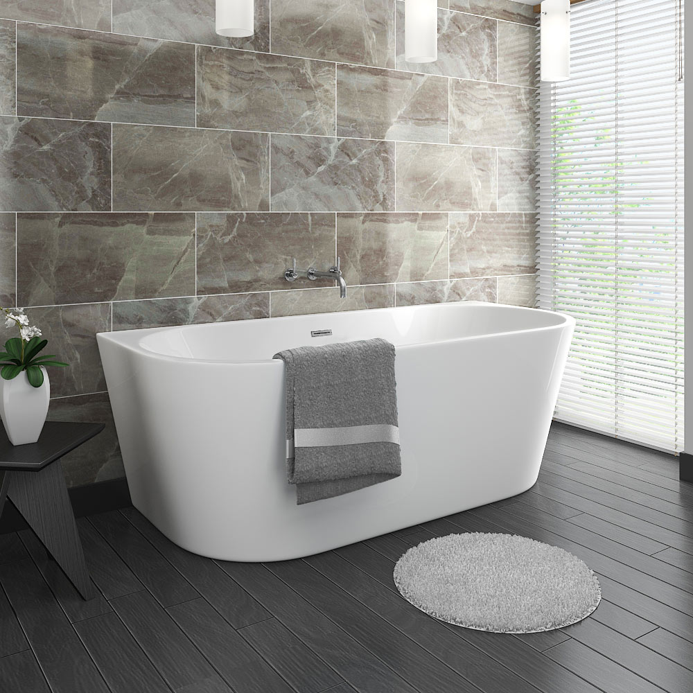 Apollo Back To Wall Modern Curved Bath (1700 x 800mm) - Close up image of a modern freestanding bath in a contemporary space