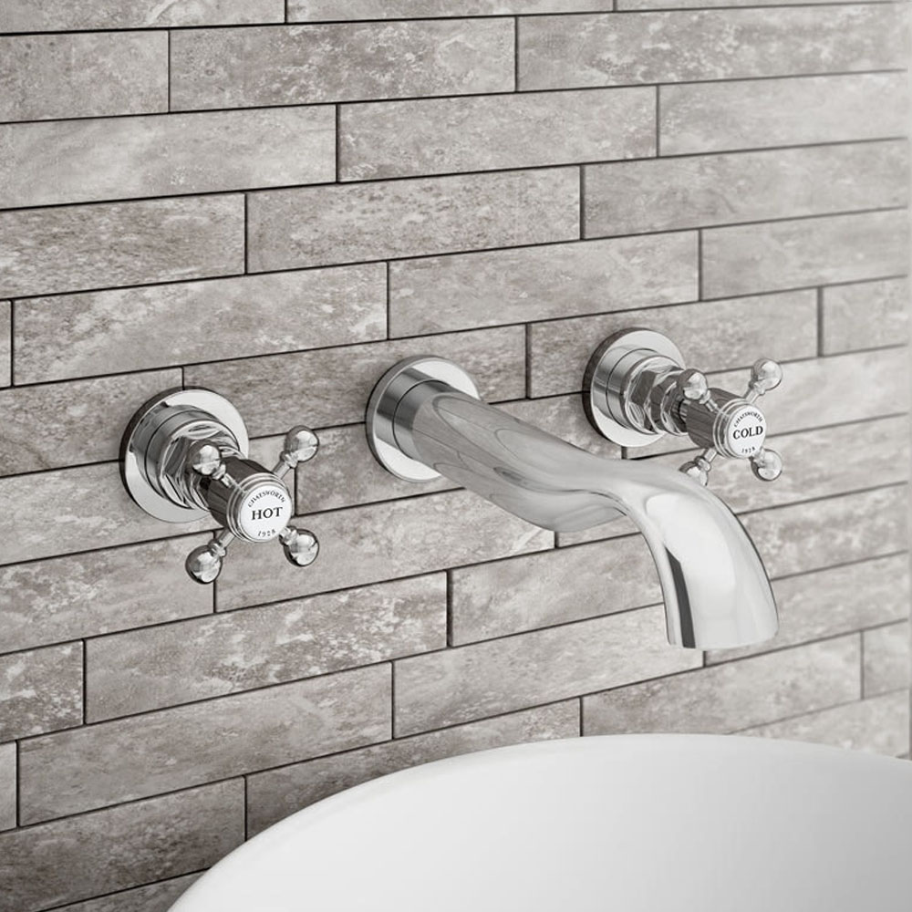 Chatsworth 1928 Traditional Wall Mounted Crosshead Bath Filler Tap - BEL16D - Close up image of chrome wall mounted bathroom tap in a bathroom with a stunning modern tiled wall