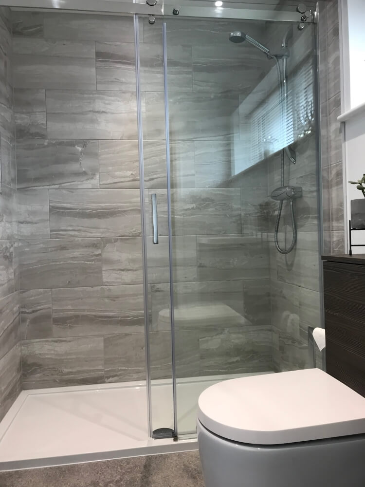 The roomy walk-in shower works wonders to make the room feel more spacious