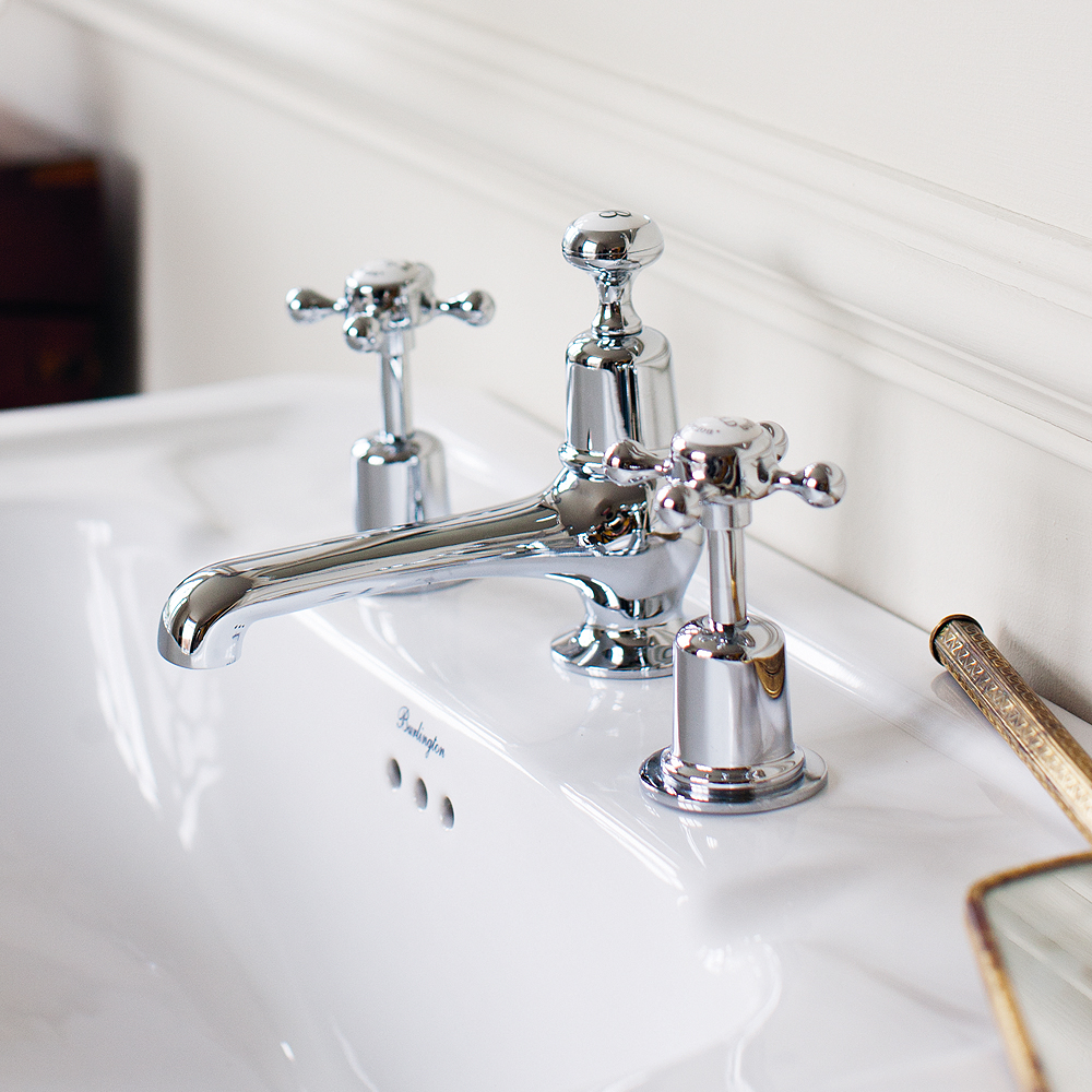 Burlington Claremont Chrome 3TH Basin Mixer with Pop Up Waste - CL12 - Close up image of chrome traditional taps next to a cream tiled wall