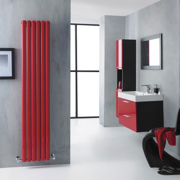 Hudson Reed Revive Double Panel Designer Radiator - HRE003 - Add style and colour to your bathroom with this stunning red vertical designer radiator. It's positioned against a light grey bathroom wall and features chrome valves which complement it beautifully. The bathroom also features more red bathroom furniture which furthers adds to this luxury designer look.
