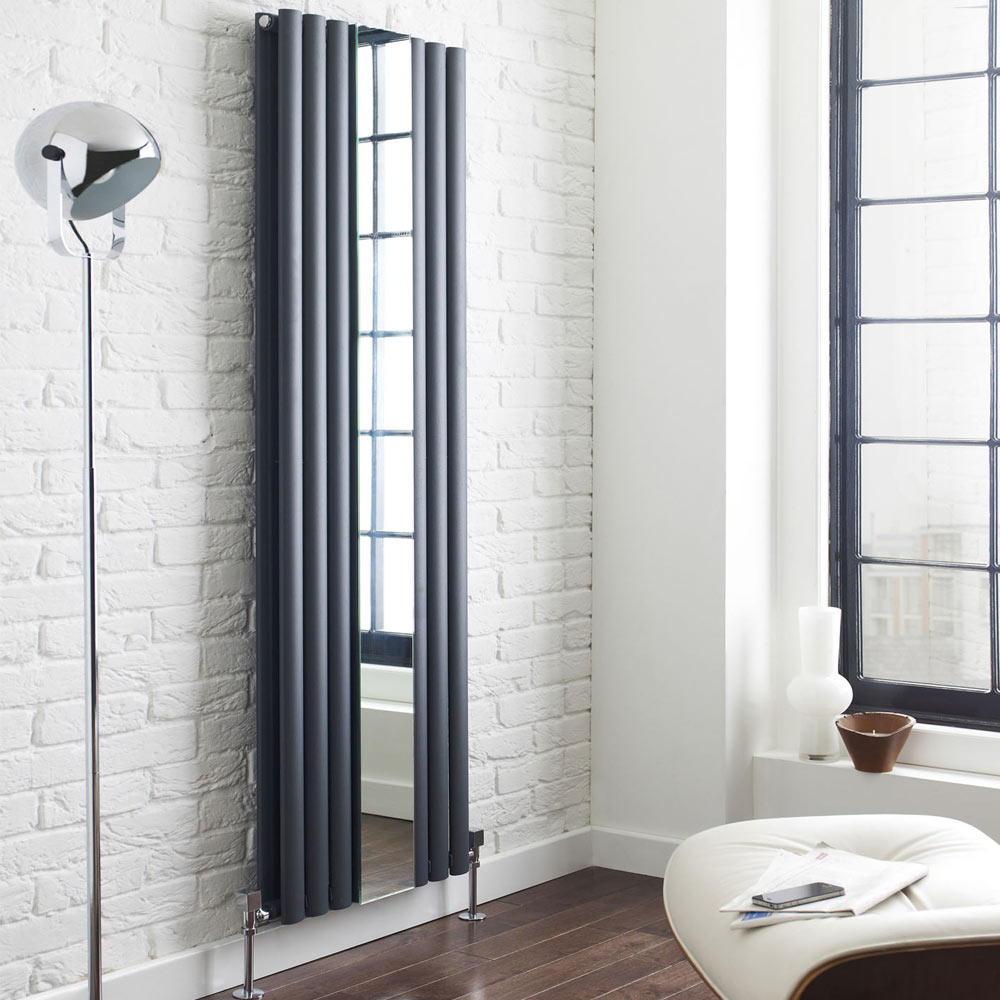 Metro Vertical Radiator with Mirror - AVT18X499M - This gorgeous vertical radiator is finished in anthracite and features a mirror inbetween 2 panels. It's fixed to a white brick wall in a contemporary setting