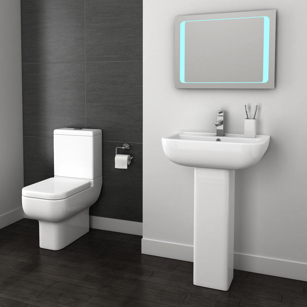 Pro 600 Modern Short Projection Toilet - located in a stylish small bathroom along with a stunning modern basin