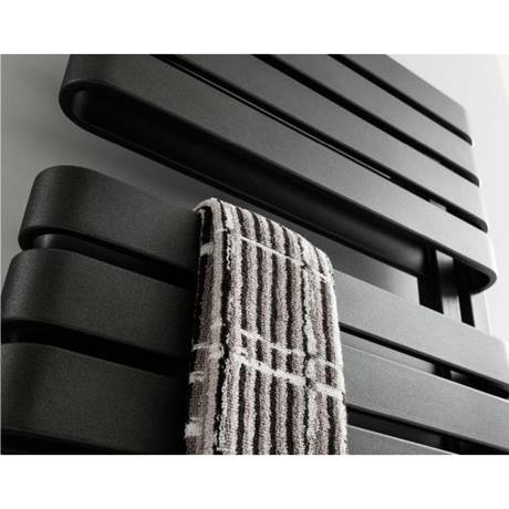 Bauhaus Svelte Towel Rail - 500 x 1695mm - Metallic Black Matte - SE50X169MB - Close up of radiator positioned against a bathroom wall