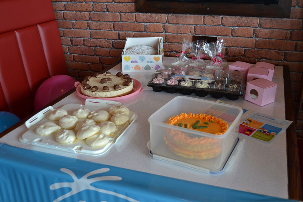 Second table full of cakes | VP's Bake Off - Claire House Children's Hospice