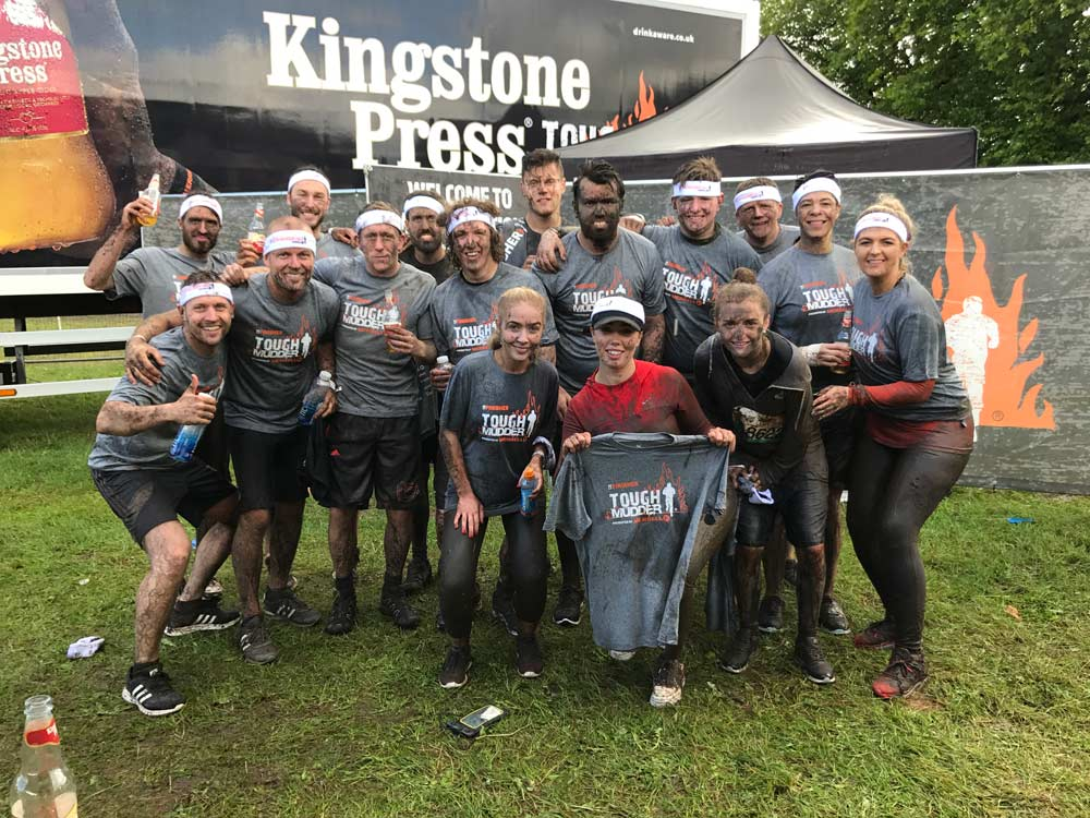 The Victorian Plumbing team photo after finishing the Tough Mudder Challenge 2017