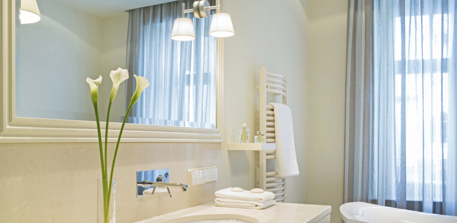 Let there be light a guide to effectively lighting your for Bathroom lighting design guide
