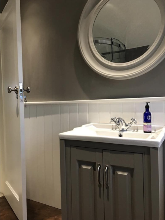 The dark traditional vanity unit and circular mirror | Emily's Traditional Bathroom - Bromley, Kent