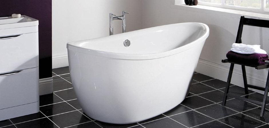 Large modern freestanding slipper tub and freestanding taps