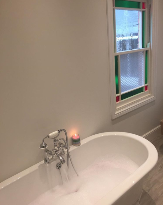 The freestanding bath being filled for a long soak | Rachel's Victorian Bathroom - Worcestershire