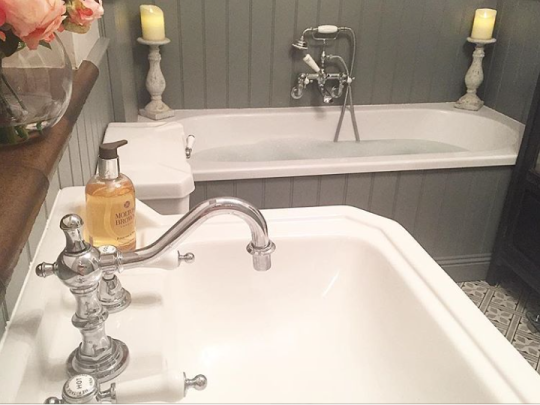 Sally's fitted bath shown from above the Edwardian wash stand | Sally's Traditional Grey Bathroom - Surrey